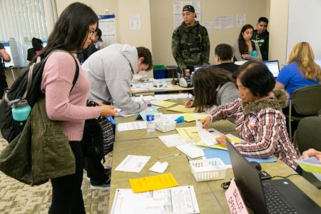 A poll worker assists a voter at the vote center in Modoc Hall Tuesday, Nov. 6, 2018. Assemblymember Ash Kalra credited Sac State for providing a real-world example for the recently signed Assembly Bill 59, which prioritizes the placement of voting centers on college campuses.