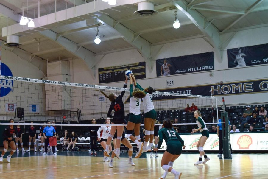 Sac State juniors Macey Hayden (left) and Cianna Andrews attempt to block a spike from Southern Utah Thursday, Oct. 3 at The Nest. Andrews recorded 12 kills and seven blocks in the loss.