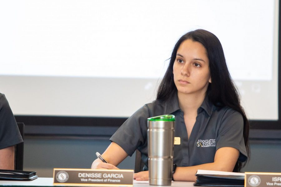 Sac+State+student%2C+Denisse+Garcia%2C+ASI+Vice+President+of+Finance%2C+takes+notes+during+an+ASI+meeting+Wednesday%2C+Oct.+4.+Garcia+is+a+DACA+recipient+who+is+currently+studying+business.