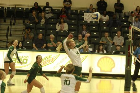Sac State sophomore middle blocker Sarah Falk prepares to spike the ball Thursday, Oct. 24, against Montana at The Nest. The Hornets won the match 3-1.