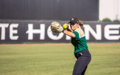 Sac State softball head coach Lori Perez throws the ball during practice Wednesday, Oct. 9 at Shea Stadium. Athletic Director Mark Orr announced Oct. 2 that Perez and Sac State agreed to a five-year contract extension that will keep Perez at the university through at least the 2024 season.