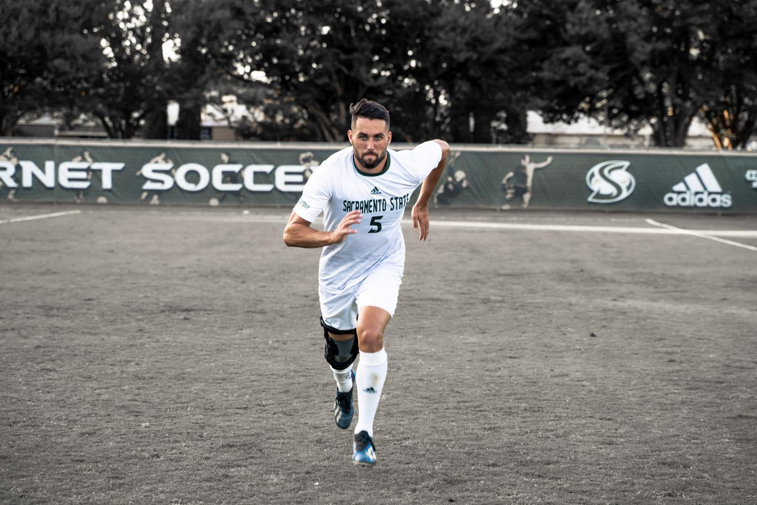 Sac State senior defender Mac Harrington runs toward the camera in this photo illustration Thursday, Sept 19, after a game against the University of San Francisco. Harrington is coming back from a torn ACL that prematurely ended his junior season Sept. 29, 2018.