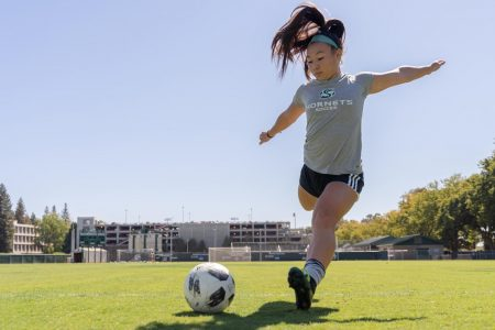 Sac State junior forward Kylee Kim-Bustillos kicks the ball at practice Tuesday, Sept. 24 at Hornet Field. Kim-Bustillos has scored 7 goals and made 3 assists thus far in the 2019 season.