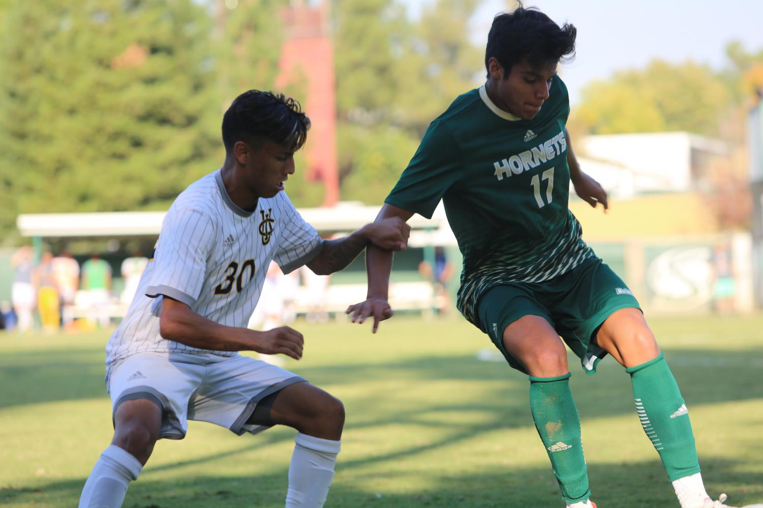 Sac State sophomore defender Alejandro Alacantaro battles for possession of the ball with UC Irvine freshman midfielder Roberto Molina Saturday Oct. 12 at Hornet Field. UC Irvine and Sac State played a 2-2 draw.