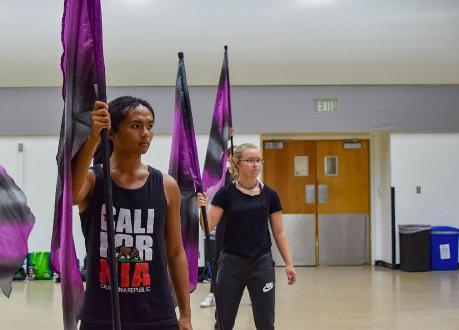 From left to right: Nathan Peralta and Jinjer Townsend, members of the Sacramento State color guard team, practicing in Capistrano Hall Wednesday Oct. 16. The Western Band Association NorCal Super Show will be hosted at Sac State Saturday, Oct. 26.