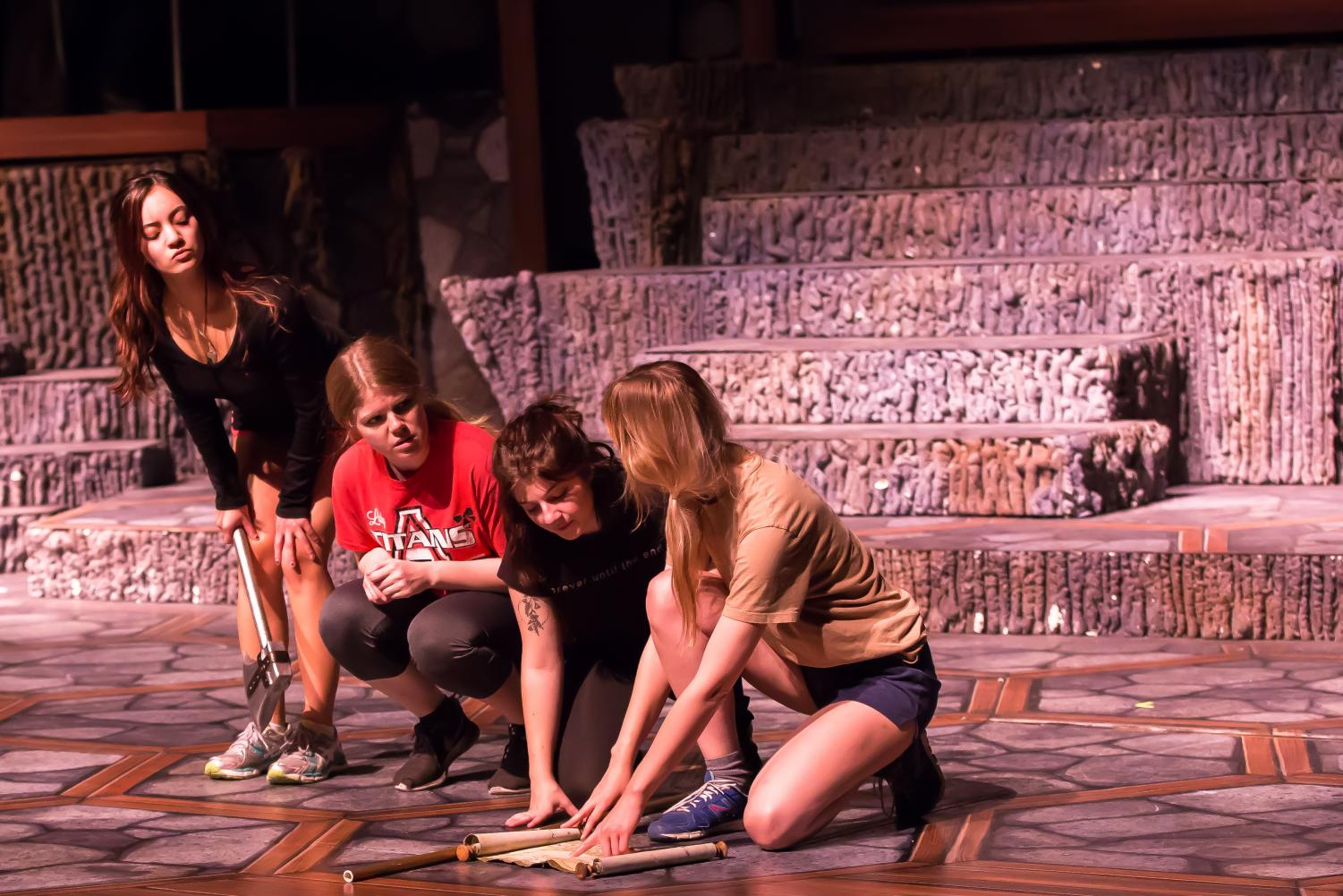 From left to right: Scarlett Pascoal (Lilith), Ana Muntean (Agnes), Nicole Kelly (Tilly) and Dagney Hollmann (the dark elf) rehearse scenes of the show Oct. 16. The center of the stage is painted to resemble a 'Dungeons and Dragons' campaign board.