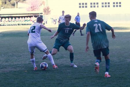 Sac State senior midfielder Matt Carnefix attempts to steal the ball from Cal Poly junior midfielder Kenneth Higgins against the Mustangs Wednesday, Oct. 23 at Hornet Field. Carnefix attempted one shot in the loss.