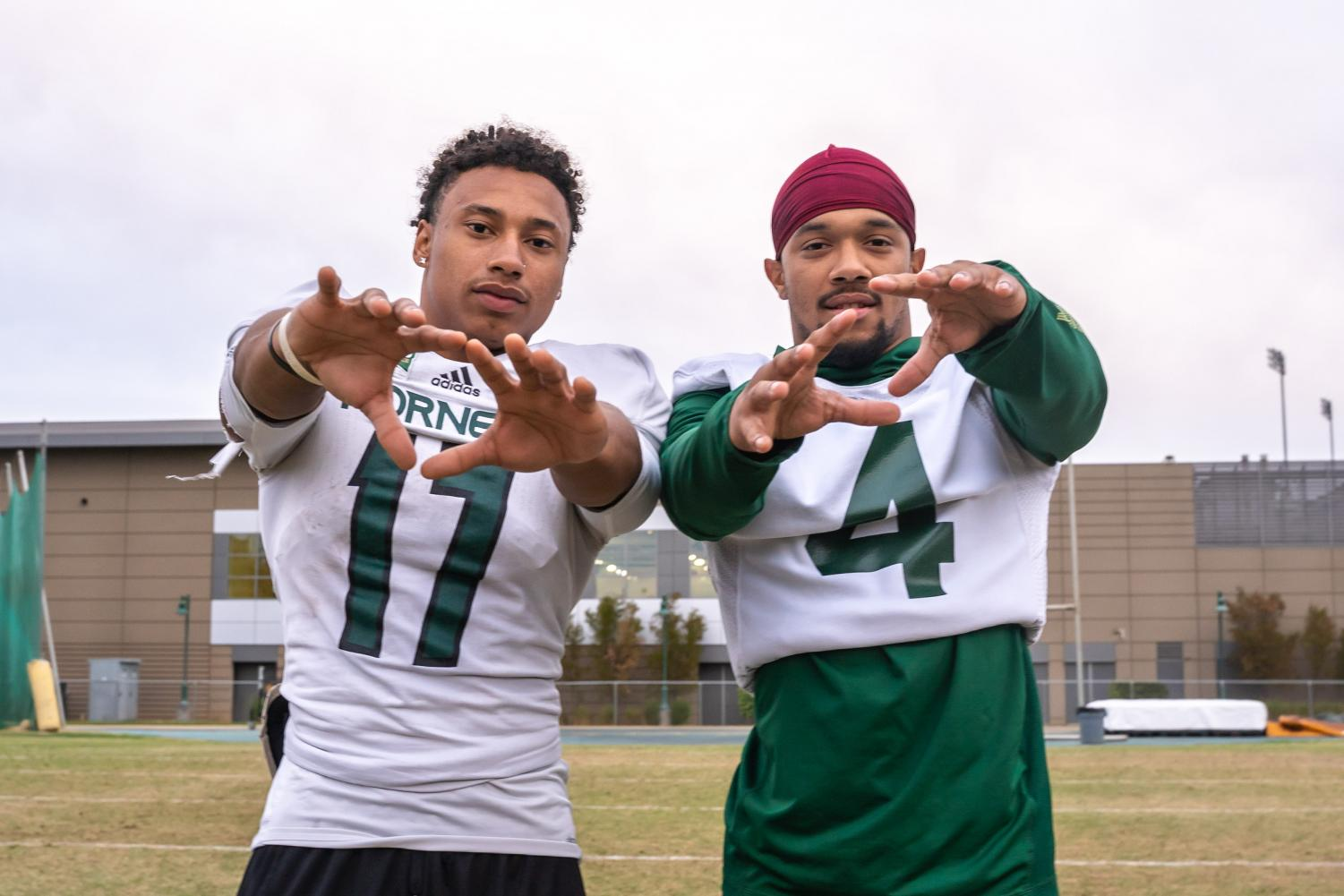 Sacramento State wide receivers sophomore Dewey Cotton and junior Isaiah Gable pose for a photo Wednesday, Oct. 16 at the practice field. Gable and Cotton both come in at 5-feet-4-inches tall on the team roster, eight inches shorter than the average height for college receivers.