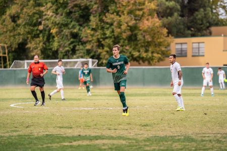 Sac State sophomore forward Benji Kikanovic runs for a play Saturday, Oct. 19 against CSU Fullerton at Hornet Field. The Sac State men