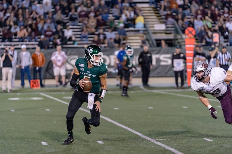 Sac+State+junior+quarterback+Kevin+Thomson+scrambles+from+the+pocket+against+Montana+Saturday%2C+Oct.19+at+Hornet+Field.+The+Hornets+will+be+on+the+road+next+Saturday+against+Cal+Poly.