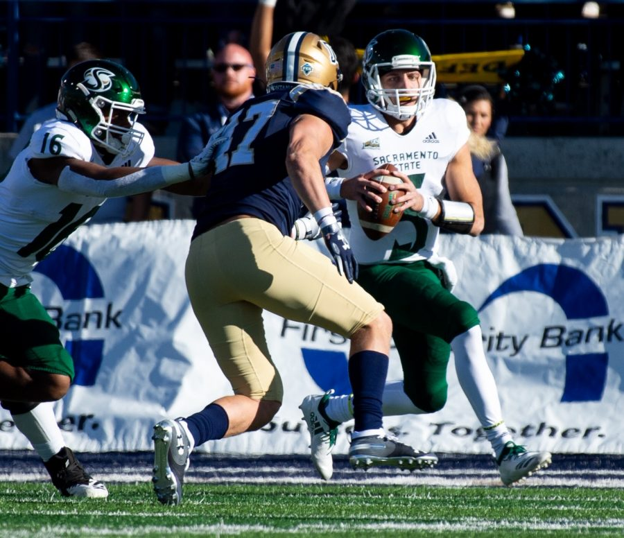 Sac State junior quarterback Kevin Thomson evades Montana State University linebacker Callahan O'Reilly Saturday, Oct. 12 at Bobcat Stadium.  The Hornets defeated the Bobcats 34-21, earning their first road win of the season.