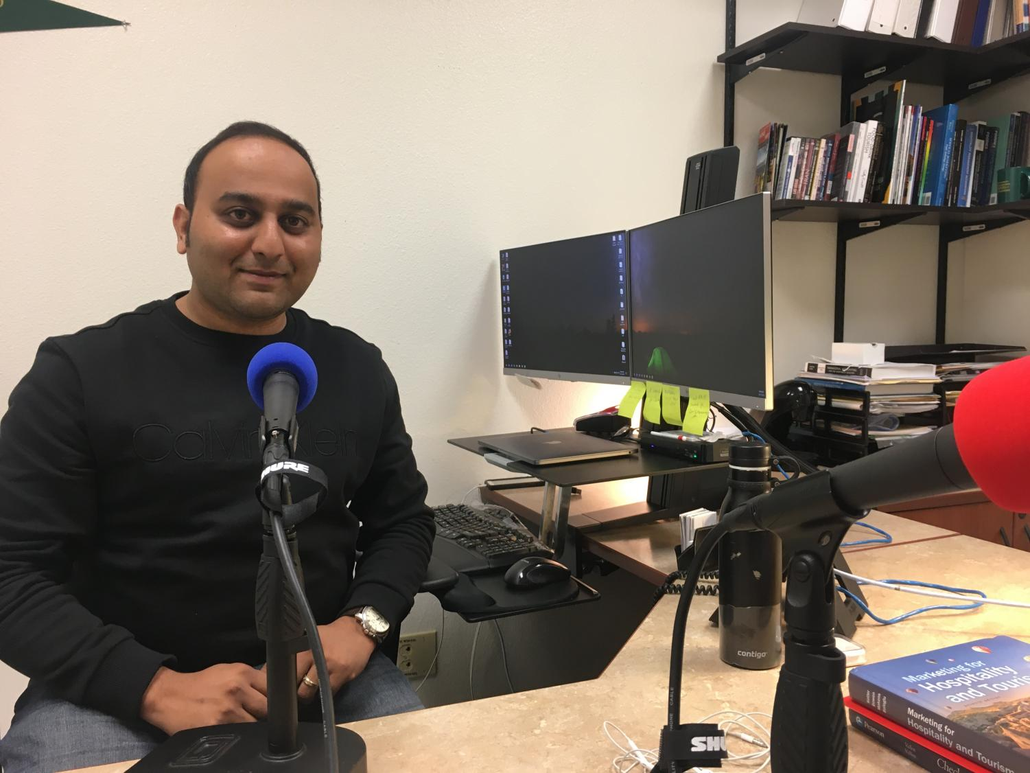 Professor of Hospitality and Tourism Abhijeet Shirsat in his office with getting ready for The State Hornet News Podcast. Shirsat's dissertation focused on fake news and its spread on social media.