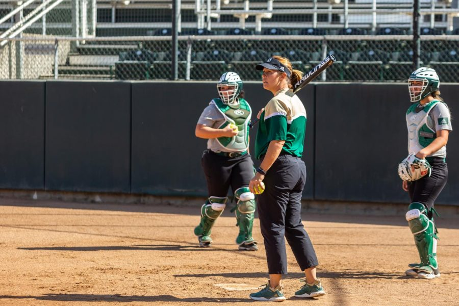 Sac State softball head coach Lori Perez prepares to hit a ball during practice Wednesday, Oct. 9 at Shea Stadium. Perez has 19 years of experience at Sacramento State, including four seasons as a player (1999-02), nine years as an assistant coach (2005-13) and six seasons as the head coach (2014-now).