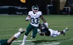 Sacramento State junior running back Elijah Dotson breaks a tackle against Cal Poly Oct. 26 at Alex G. Spanos Stadium. The Hornets defeated the Mustangs 38-14 Saturday night.