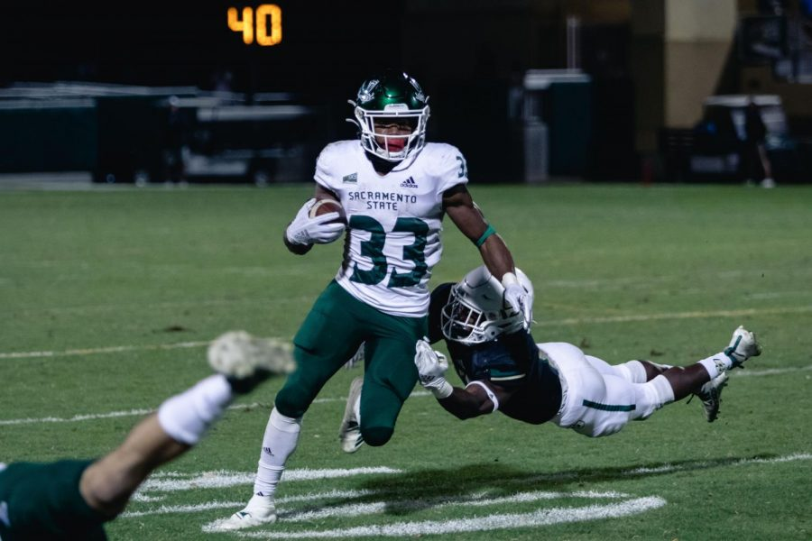 Sacramento+State+junior+running+back+Elijah+Dotson+breaks+a+tackle+against+Cal+Poly+Oct.+26+at+Alex+G.+Spanos+Stadium.+The+Hornets+defeated+the+Mustangs+38-14+Saturday+night.