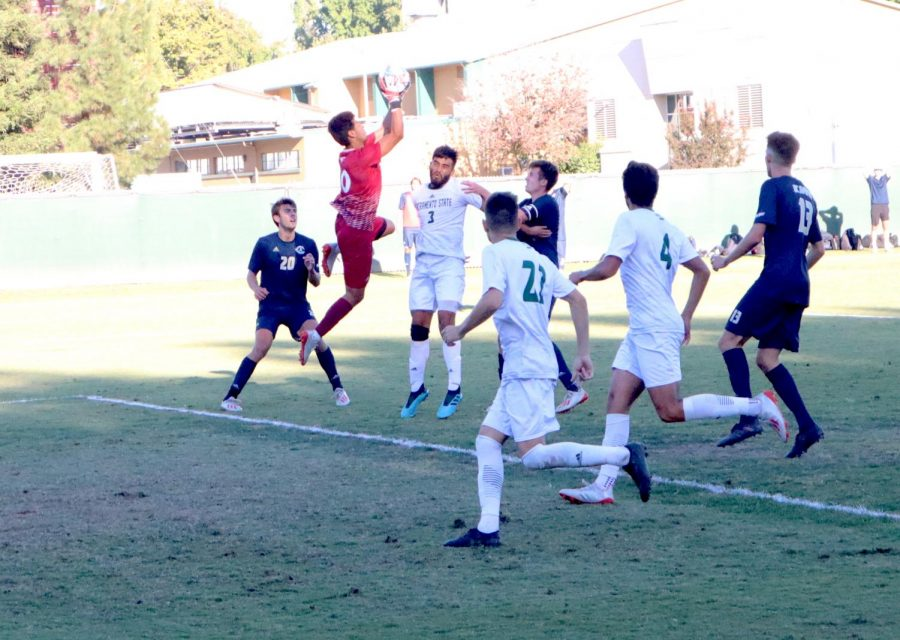 Sac State junior goalkeeper Hector Grajeda makes a save against UC Davis Saturday Oct. 5 at Hornet Field. UC Davis went on to win 2-1 in overtime.