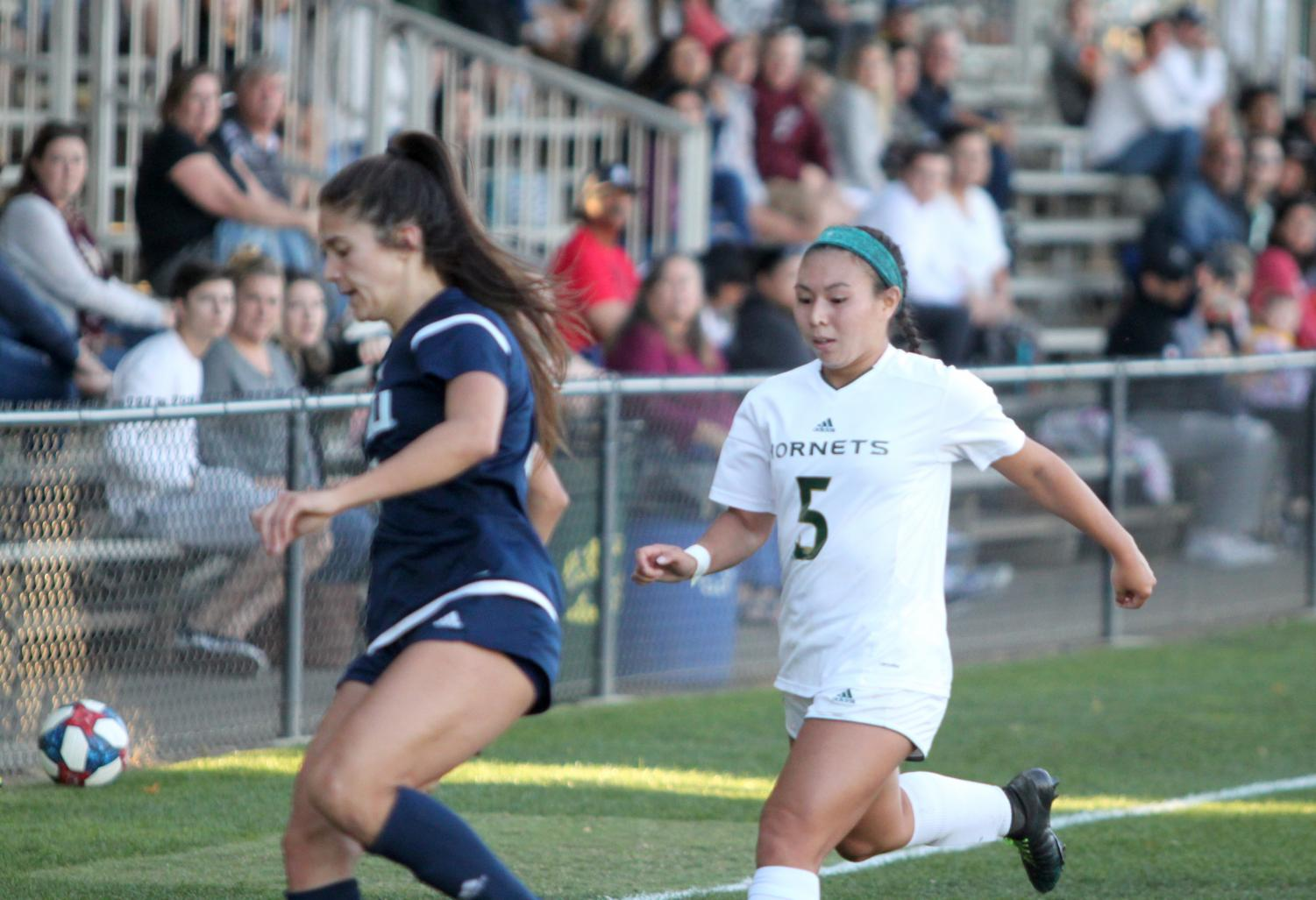 Sac State junior forward Kylee Kim-Bustillos attempts to steal the ball against Northern Arizona Friday, Oct. 4 at Hornet Field. Kim-Bustillos scored one goal in the Hornets 3-0 win against Southern Utah Sunday.