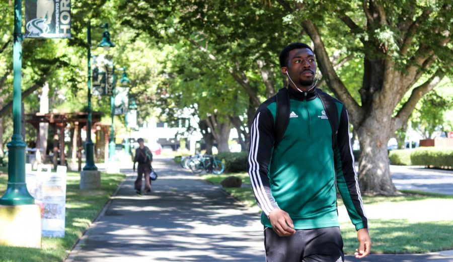 Sac State men's basketball team captain Joshua Patton takes a morning walk through campus Wednesday Oct. 2. His teammates and coaches call him an