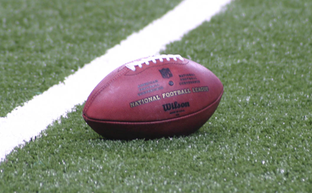 A certified NFL Football sits on an astroturf field. After the Sunday, Nov. 17 fight with Pittsburgh Steelers quarterback Mason Rudolph, Cleveland Browns defensive end Myles Garret should be fully removed from the NFL, The State Hornet opinion writer Jordan Parker writes.