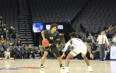 Sac State sophomore guard Brandon Davis pivots while being guarded by UC Davis freshman guard Ezra Manjon on Wednesday, Nov. 20 at Golden 1 Center. The Hornets lost their first game of the season Saturday night 59-45 at No. 21 Colorado.