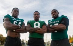 From left to right, Sac State senior football players, defensive lineman George Obinna, defensive back Caelan Barnes and defensive lineman Dariyn Choates pose for a photo after practice. Sac State's defense has accumulated 38 sacks this season through ten games, the most in the Big Sky.