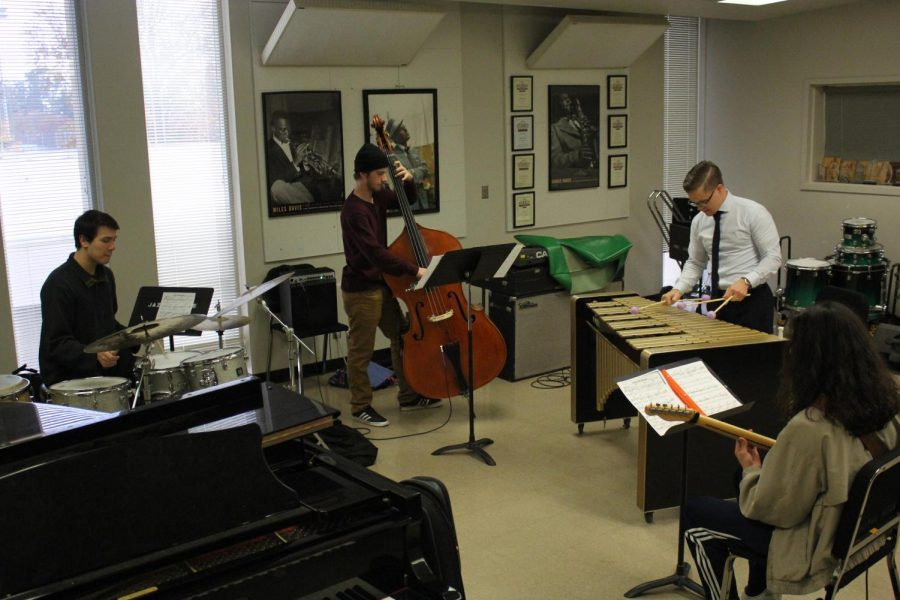 Jazz+studies+students+Zach+Martin+on+guitar%2C+Gabe+Carpenter+on+drums%2C+Tyler+Miles+on+bass+and+lecturer+Tristan+Rogers+on+vibraphone+rehearse+for+the+upcoming+Jazz+Combo+concert.+Jazz+Combos+are+bands+made+up+of+Sac+State+student+and+alumni+musicians.