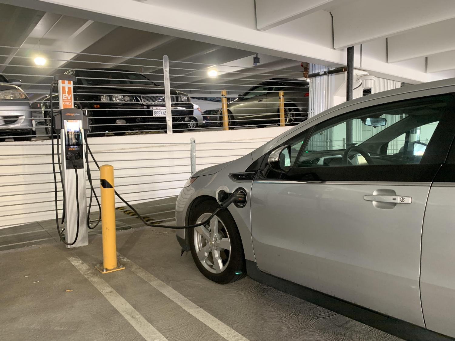 A Chevrolet Volt charges on campus in Parking Structure V. There is a maximum of $44 per charging session.
