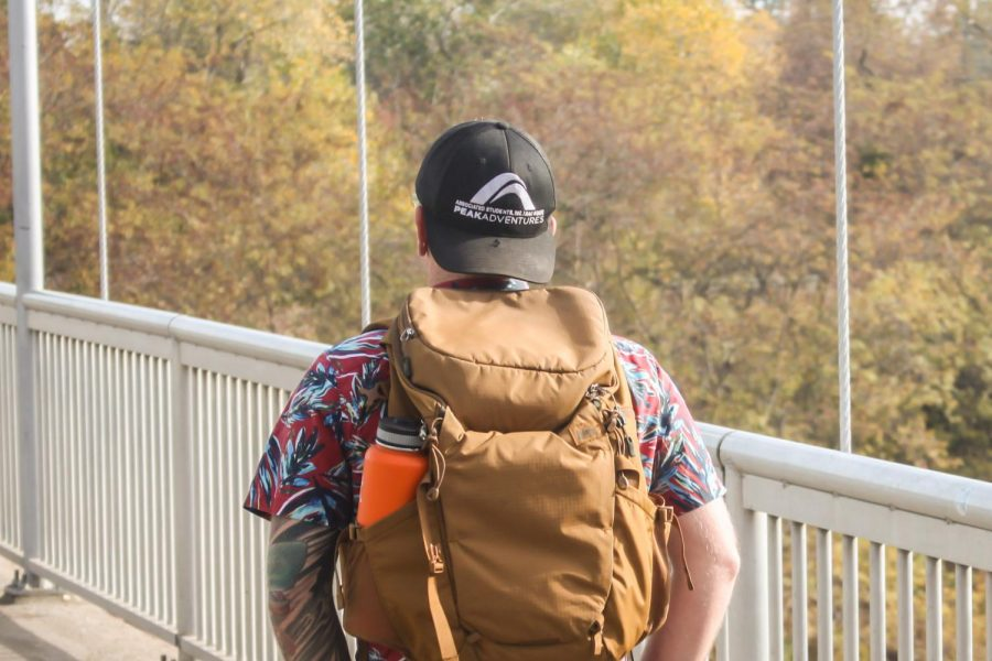 Kyle Murphy, a communication studies major, walking on the Guy West Bridge at Sacramento State. Murphy works with Peak Adventures at the Challenge Center and also serves as a whitewater rafting guide.