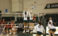 Sac State junior middle blocker Cianna Andrews (left) and freshman outside hitter Kayla Subbert barely miss blocking against Eastern Washington at The Nest. Andrews had a total of nine successful blocks during Saturday's loss.