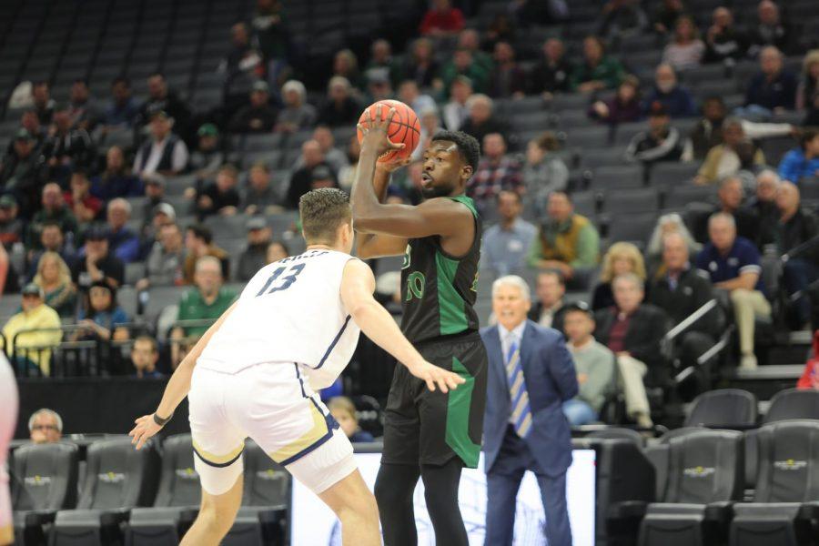 Sac State senior center Joshua Patton looks to make a pass against UC Davis senior center Matt Neufeld on Wednesday, Nov. 20 at Golden 1 Center. The Hornets defeated the Aggies 61-51 to move to 3-0 on the season.