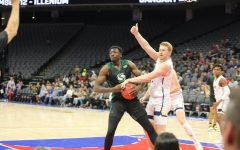 Sac State senior center Joshua Patton fights for a loose ball with UC Davis junior forward Kennedy Koehler on Wednesday, Nov. 20 at Golden 1 Center. The mens basketball team is currently in Boise, Idaho competing in the Big Sky Conference Tournament