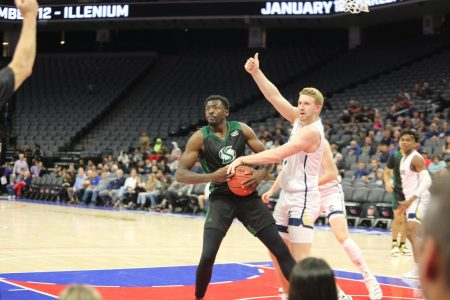 Sac State senior center Joshua Patton fights for a loose ball with UC Davis junior forward Kennedy Koehler on Wednesday, Nov. 20 at Golden 1 Center. The men's basketball team is currently in Boise, Idaho competing in the Big Sky Conference Tournament