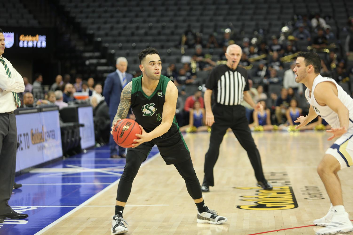 Sac State senior guard Izayah Mauriohooho-Le'afa attempts to make a bounce pass against UC Davis senior guard Stefan Gonzalez on Wednesday, Nov. 20 at Golden 1 Center. Mauriohooho-Le'afa had a game-high 23 points in the Hornets 77-72 win on the road at Pepperdine on Saturday night.