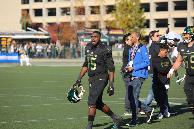 Sac State senior defensive lineman Dariyn Choates pumps up his teammates before playing UC Davis on Saturday, Nov. 23 at Hornet Stadium. Choates had three tackles in the win.