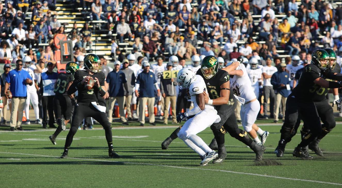 Sac State junior quarterback Kevin Thomson stands in the pocket amid pressure from UC Davis against the Aggies on Saturday, Nov. 23 at Hornet Stadium. The No. 4 Hornets host the second round of the FCS Playoffs at 6 p.m. next Saturday, Dec. 7 at Hornet Stadium.