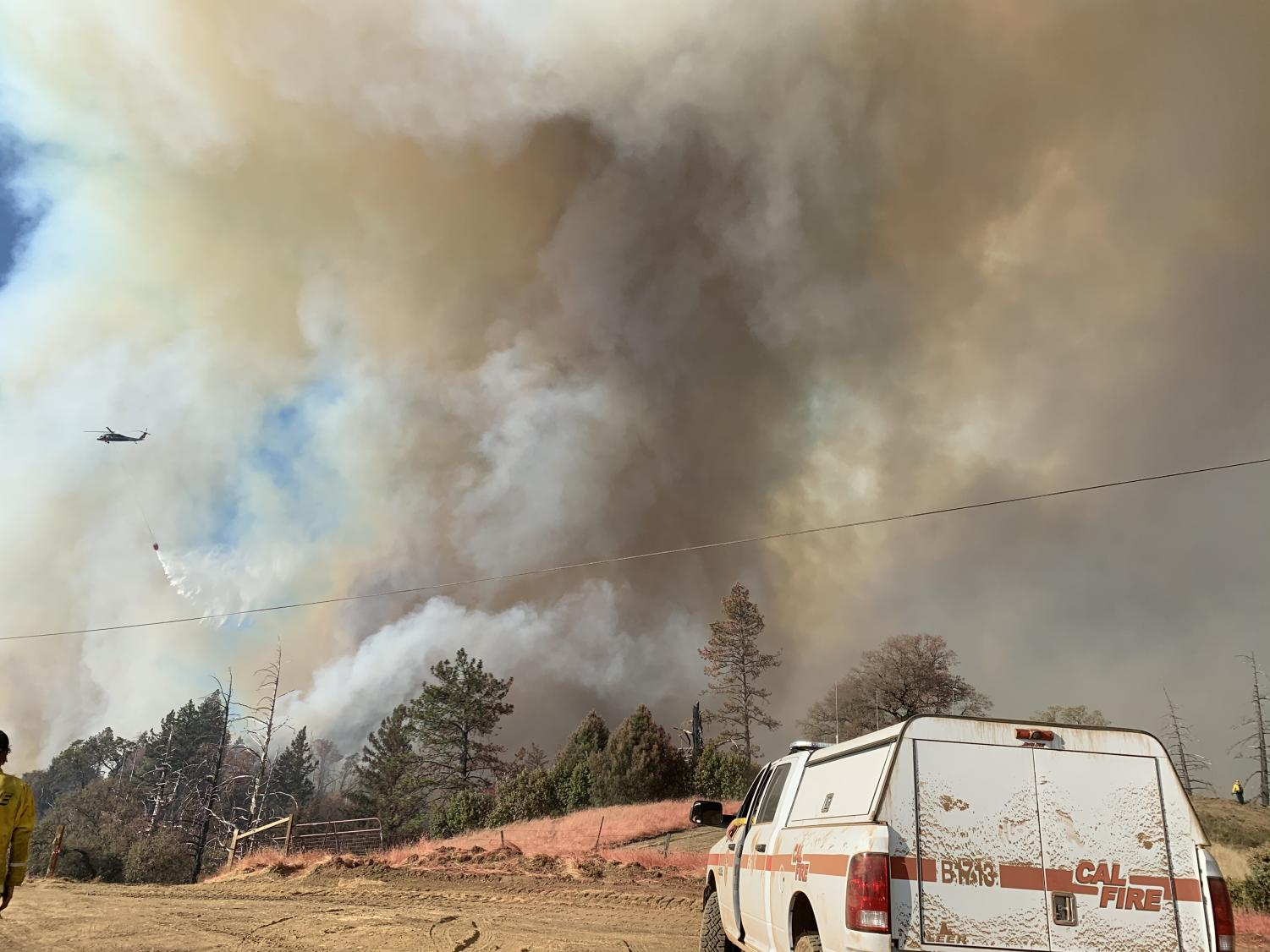Cal Fire firefighter Xavier Chavez shoots pictures with his phone while helping fight the Kincade Fire in Sonoma county. The fire destroyed 374 structure and on Monday a federal judge ordered an investigation as to whether a transmission line malfunction reported by PG&E was the cause of the fire.