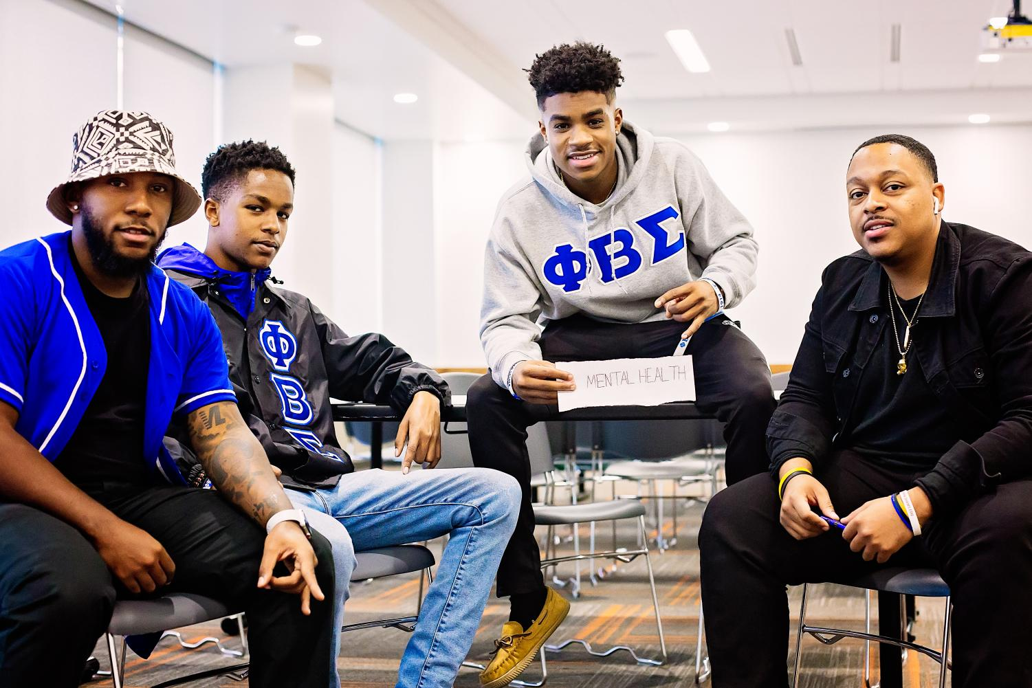 From left to right: Phi Beta Sigma members Stephen Arnold, John Kimani,  Malachi Powell, and Mark Hamlett. The fraternity is hosting the