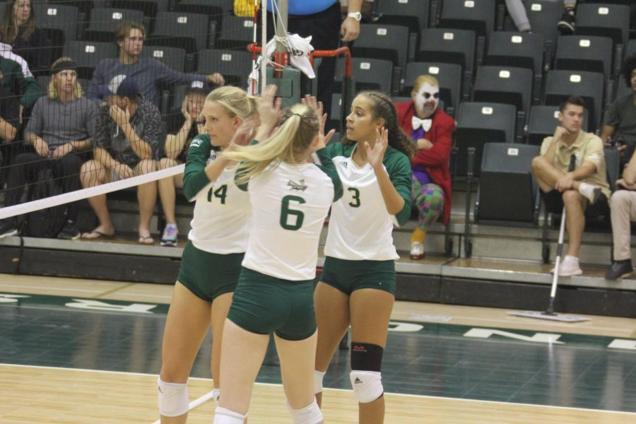 Sac State sophomore Sarah Falk, freshman Kayla Subbert, and junior Macey Hayden come together on Thursday, Oct. 31, against Idaho at The Nest. The Hornets came back from a 2-0 deficit to win the match.