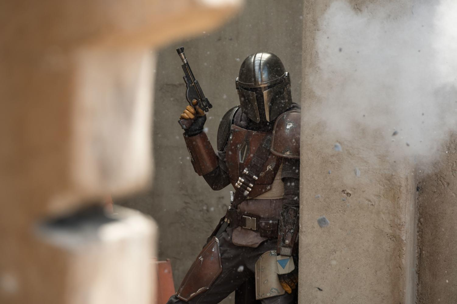 Pedro Pascal's title character takes cover during a gunfight in the first episode of