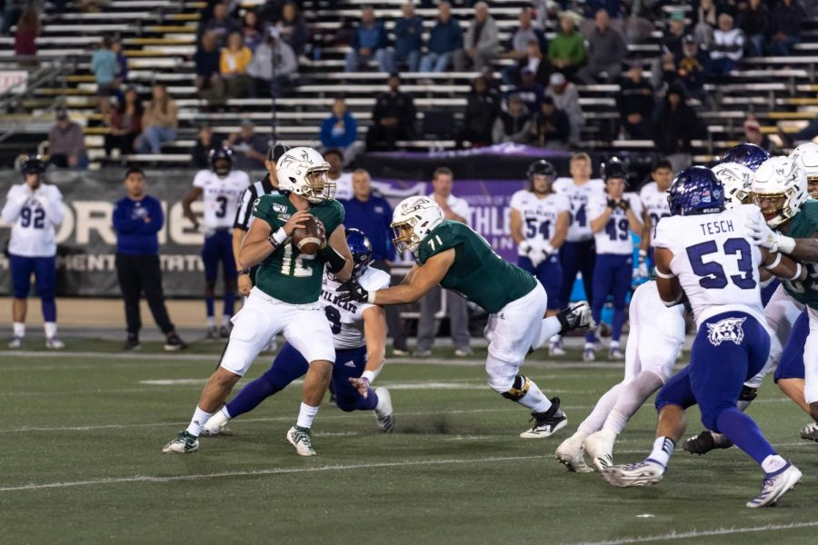 Sac State sophomore quarterback Jake Dunniway prepares to throw against Weber State on Nov. 2 at Hornet Stadium. In his first start of the season, Dunniway completed 27 of 44 passes for 384 yards, four touchdowns and one interception in the 38-34 win at Northern Arizona on Saturday.