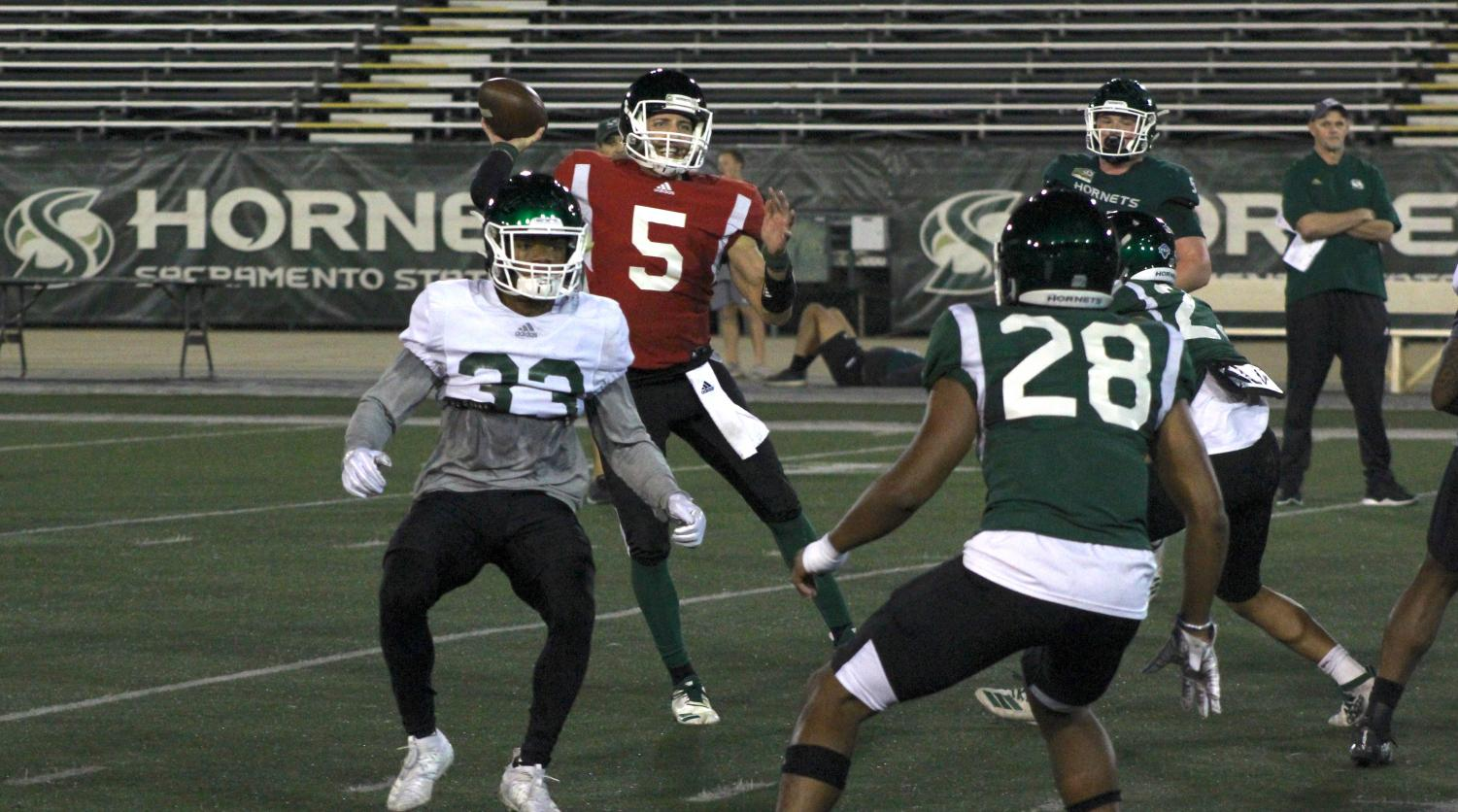Sac State junior quarterback Kevin Thomson throws a pass during practice Tuesday, Nov. 19 at Hornet Stadium. The Hornets play UC Davis in the 66th annual Causeway Classic on Saturday.
