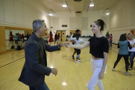 Gymnastics head coach Randy Solorio dances with senior kinesiology major Viktoriya Rizvanova in the ballroom dancing class Solorio teaches at Sacramento State. Solorio has been coaching gymnastics at Sac State since 1986.