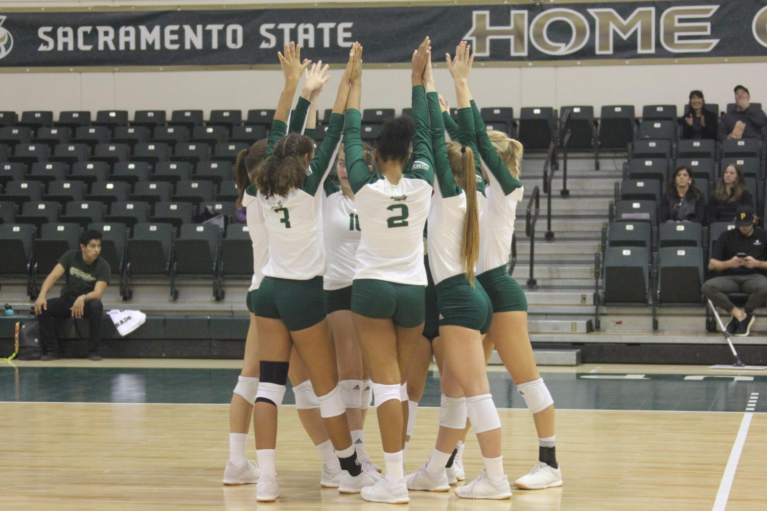 Members of the Sac State volleyball team celebrate a set win against Idaho on Thursday, Oct. 31 at The Nest. The Hornets went 1-1 on their recent road trip and now have a record of 13-14 (8-6 Big Sky Conference) headed into the final two weeks of the regular season.