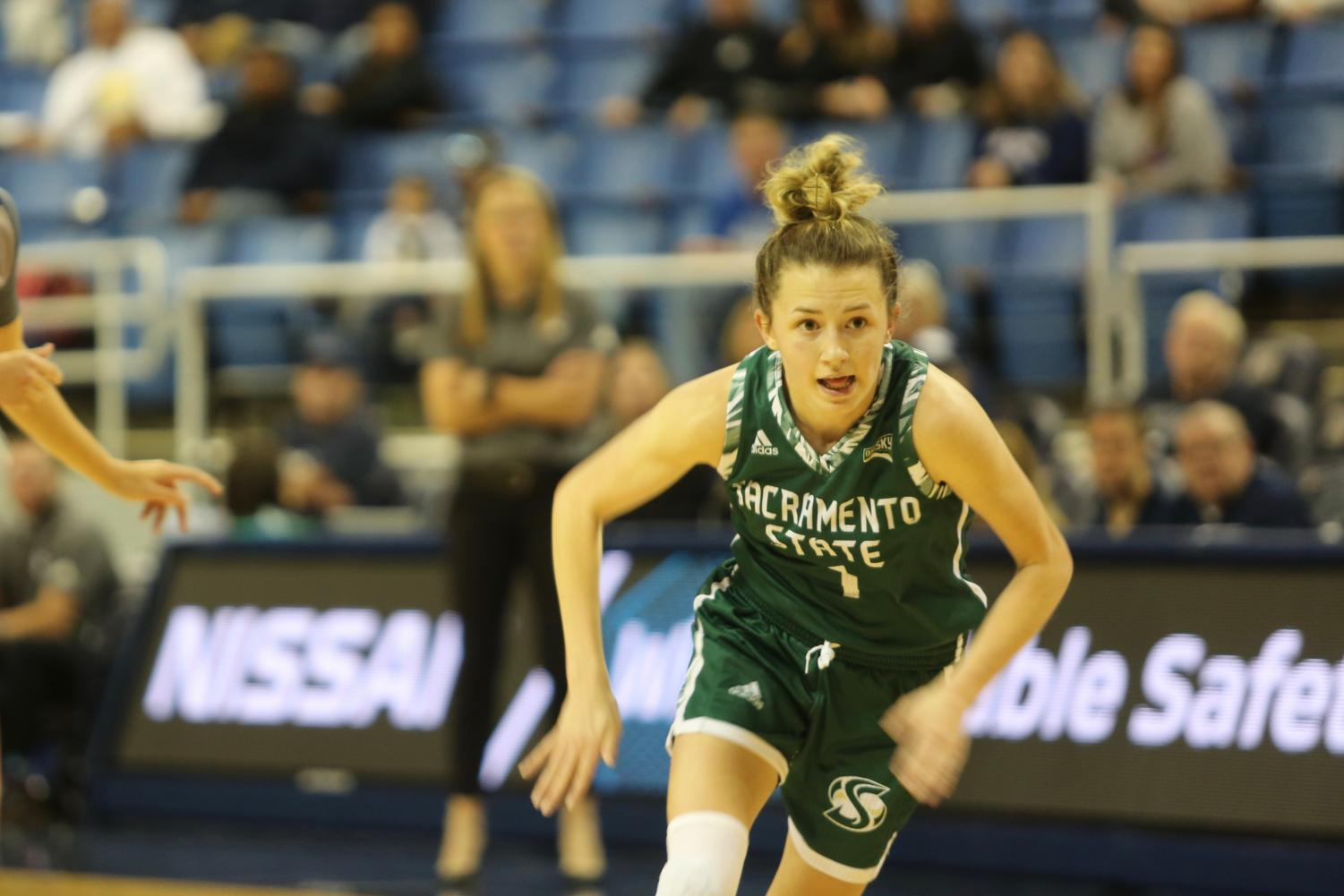 Sac State sophomore point guard Milee Enger pursues a loose ball in the third quarter at Nevada on Saturday, Nov. 9 at Lawlor Events Center in Reno, Nevada. The Hornets lost on the road to Cal Poly on Wednesday 62-43.