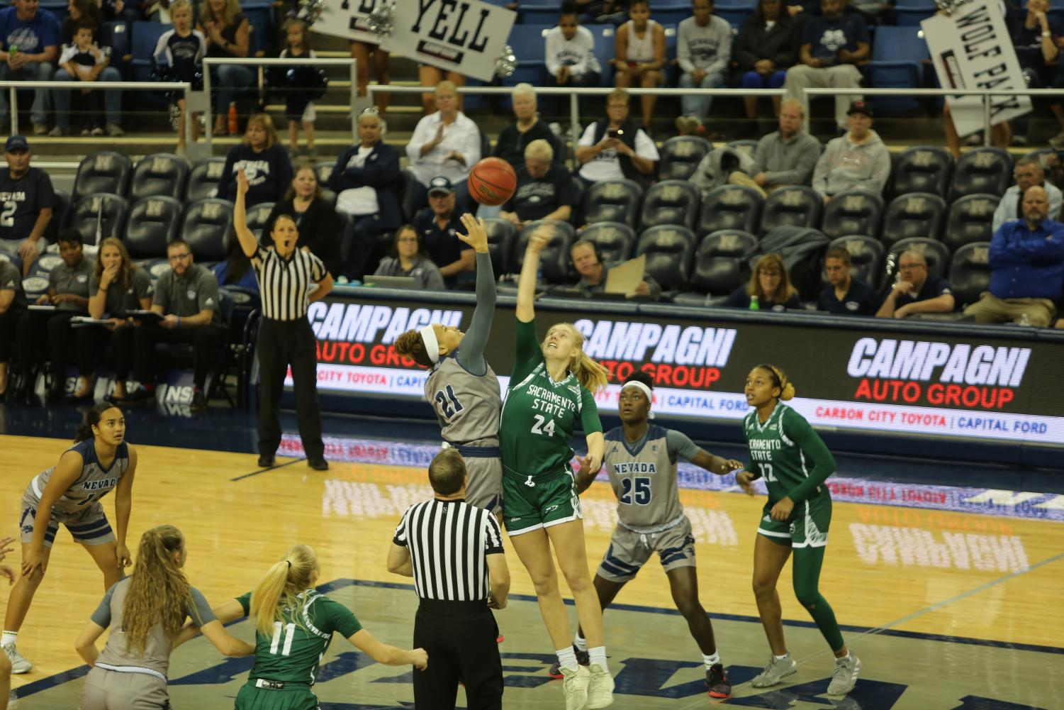 Sac State sophomore forward Tiana Johnson battles Nevada sophomore forward Imani Lacy for the opening tip on Saturday, Nov. 9 at Lawlor Events Center in Reno, Nevada. The Hornets led after the first half, but ultimately lost 83-72 to the Wolf Pack.