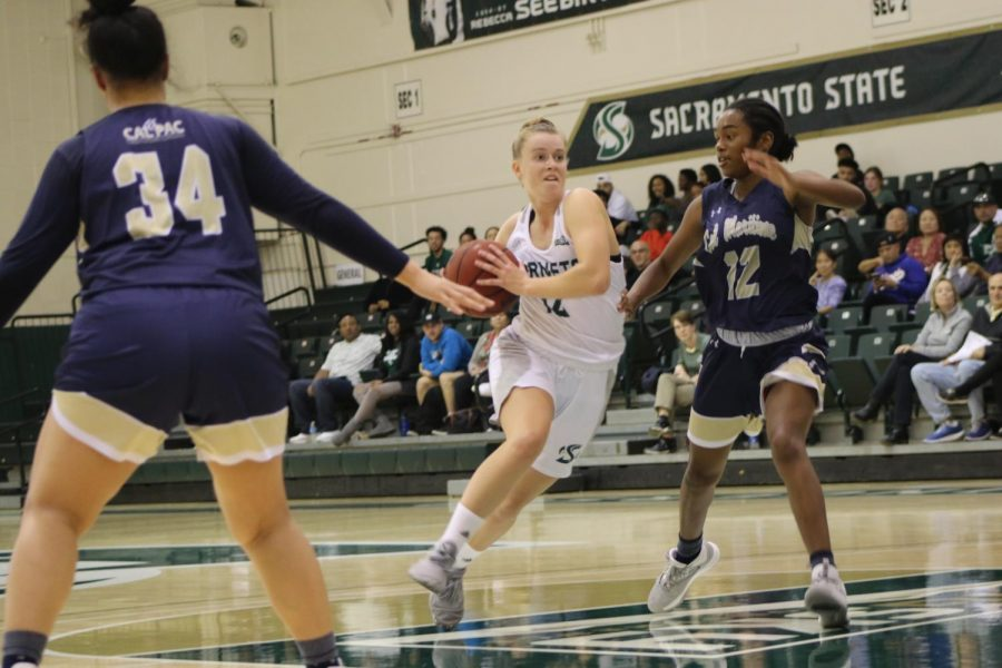 Sac+State+sophomore+guard+Emily+Enochs+drives+to+the+basket+against+Cal+State+Maritime+Academy+on+Wednesday%2C+Nov.+13+at+The+Nest.+The+Hornets+beat+the+Keelhaulers+86-+55.
