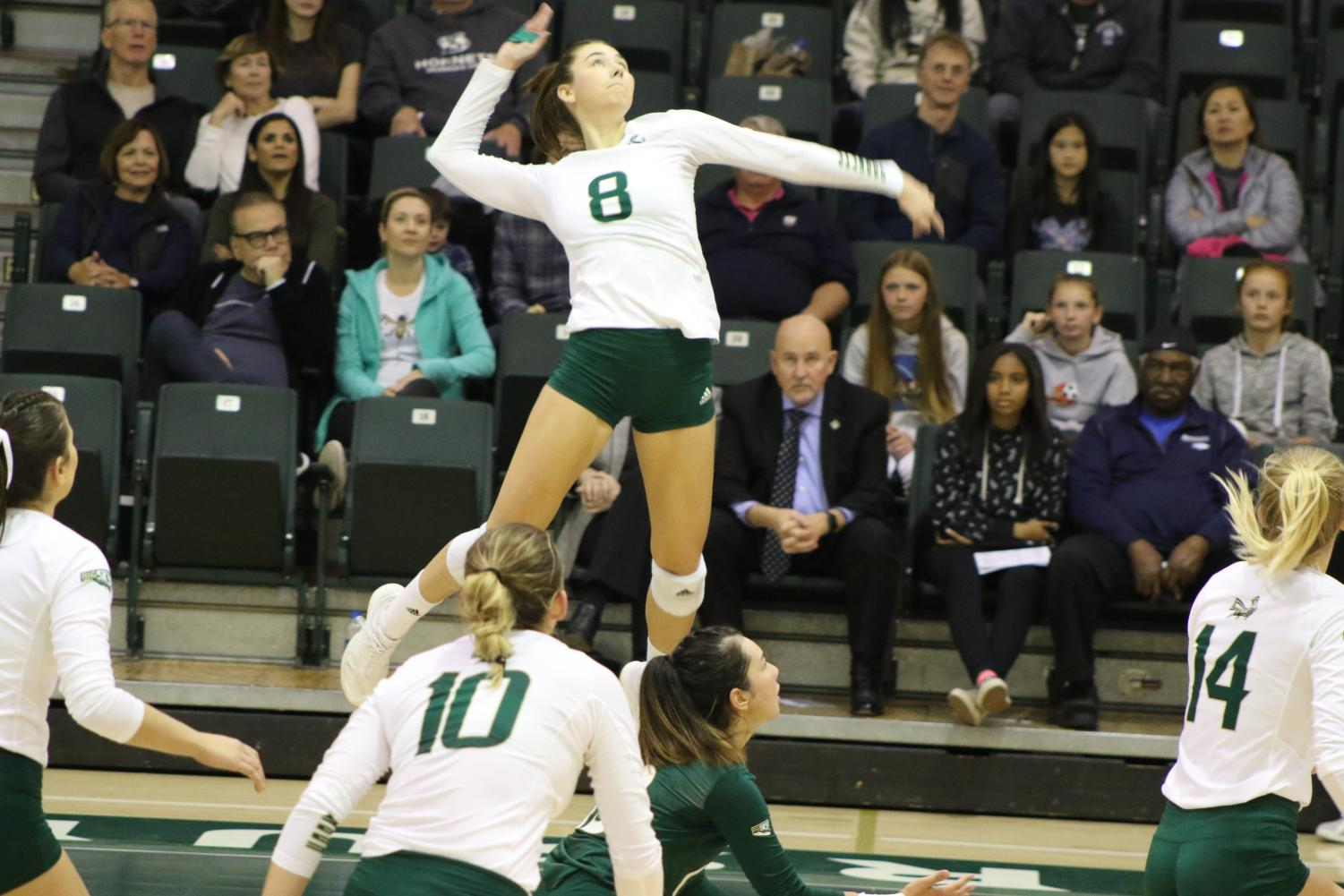 Sac State senior outside hitter Sarah Davis spikes the ball against Weber State on Thursday, Nov. 14 at The Nest. Sac State lost to the Wildcats in three sets.