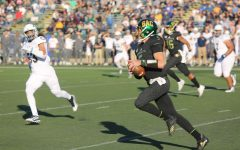 Sac State junior quarterback Kevin Thomson rushes for a first down against UC Davis on Saturday, Nov. 23 at Hornet Stadium. The No. 4 Hornets defeated the Aggies 27-17 in the 66th Causeway Classic.