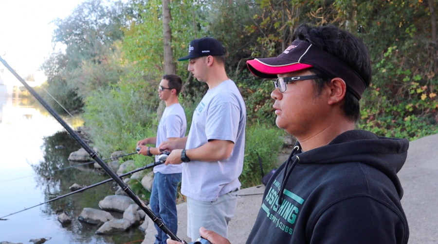 From left, Sac State Bass Fishing Club members Ilya Guryanov, Christopher Orgon and Aaron Nguyen fish by the Guy West Bridge Oct. 22. The club took first and second place in the Fishing League Worldwide Tournament on the California Delta.
