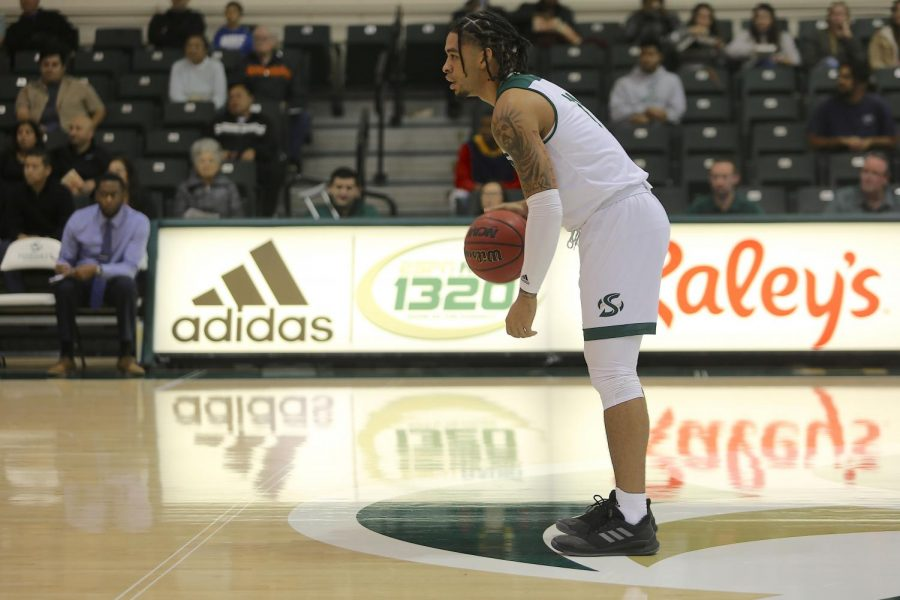 Sac State sophomore guard Brandon Davis dribbles near midcourt and surveys the floor against UC Merced on Tuesday, Dec. 3 at the Nest. Davis had five points and four assists in the win.